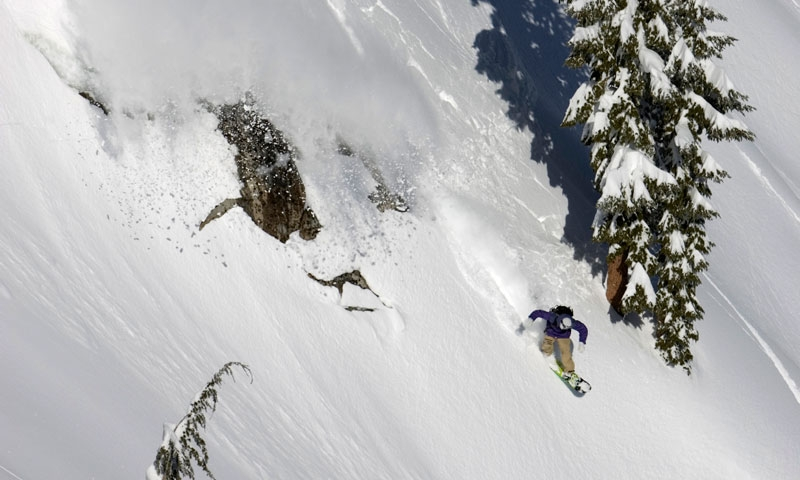 Snowboarding a steep line at Squaw Valley Ski Resort